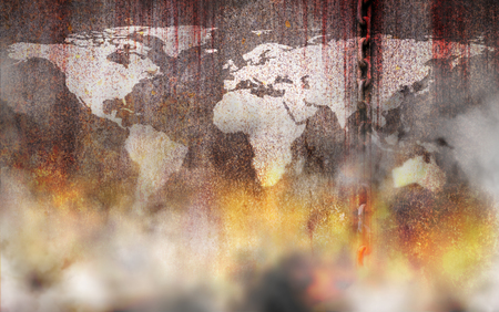 Bloody and white world map background scary old rusty chains hanging on rusted steel wall with fire and smoke, concept of the use of slave labor and holocaust Stock Photo