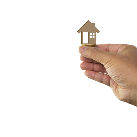 Man hand holding wooden toy house isolated on white background