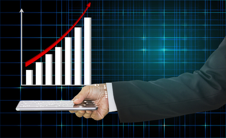 Businessman hand holding mobile phone and the graph is shown above with red arrow indicates economic, concept of technology and growth of business
