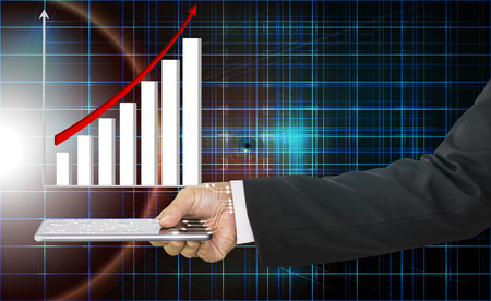 Businessman hand holding mobile phone with circuit and the graph is shown above with red arrow indicates economic, concept of technology and growth of business