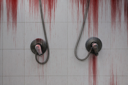 Bloody background scary with drops water on the shower valve handle for swimming pool, concept of horror and Halloween Imagens