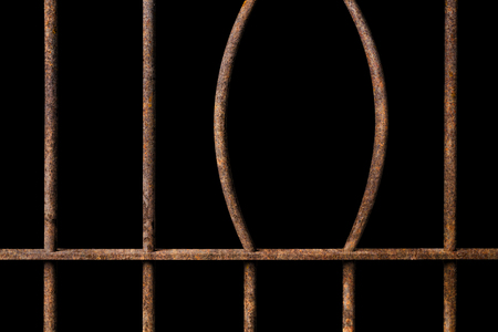 Broken old prison rusted metal bars on black background, concept of escape