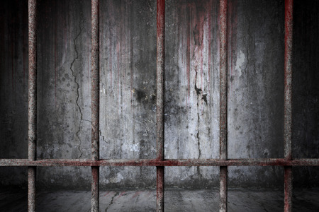 Old prison rusted metal bars cell lock with bloodstain and bloody background scary old wall, concept of strengthen and protect with horror