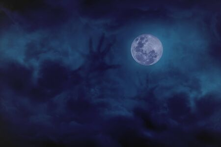 Blue full moon with cloud demon on blue darkness sky, concept of horror
