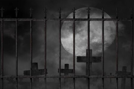 Scary background cemetery cross and graveyard fence with dark silhouette in large moon, concept of horror and Halloween
