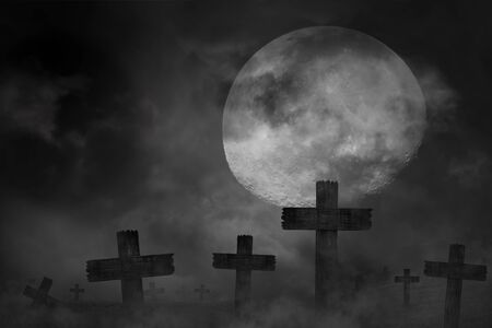 Scary background cemetery cross with dark silhouette in large moon, concept of horror and Halloween Stock Photo