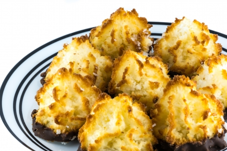 Coconut macaroons attached to chocolate on white plate Stock Photo