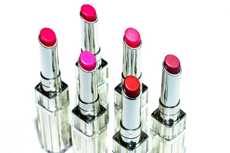 gamma tone: Set of red lipsticks isolated on white background