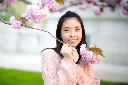 Beautiful girl in blossom garden photo