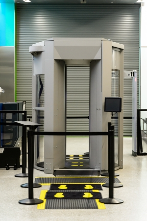 metal detector: Security check at airport metal detector