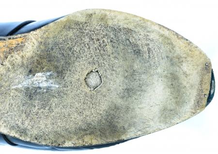 modish: worn sole of shoes isolated on white background