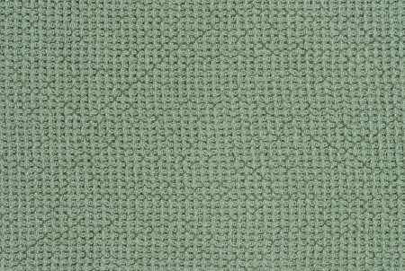 Green knitted textured background Stock Photo