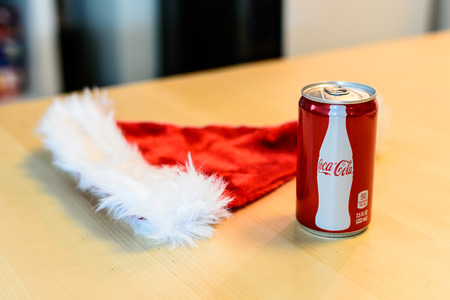 BOSTON, USA - DECEMBER 28, 2013: Photo of a Coca-Cola can with a Santa Claus hat. Coca-Cola was ranked on the 2011 Fortune Global 500, a list of the worlds largest companies.