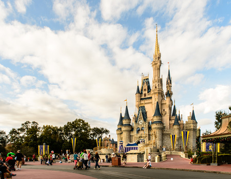 kingdoms: ORLANDO, USA - December 20, 2013: Cinderella castle at Walt Disney World in Orlando. Walt Disney World resort is opened in October 1, 1971 as an entertainment complex.