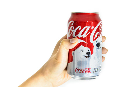 BOSTON, USA – DECEMBER 28, 2013: Photo of a Coca-Cola can held with a hand. Coca-Cola was ranked on the 2011 Fortune Global 500, a list of the worlds largest companies.