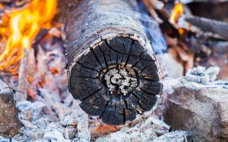 smoldering: smoldering timber in the bonfire.