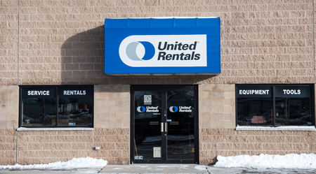 Winneconne, WI - 1 Jan 2016: United Rentals sign and entrance.  They rent equipment for just about any job out there.