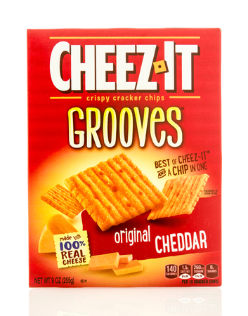 grooves: Winneconne, WI - 19 May 2016:  Box of Cheez it grooves original cheedar crackers on an isolated background Editorial