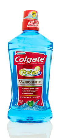 halitosis: Winneconne, WI - 20 May 2016:  Bottle of Colgate total mouthwash on an isolated background