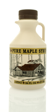 family owned: Winneconne, WI -  17 Jan 2016: Bottle of Klebenows pure maple syrup that is family owned.
