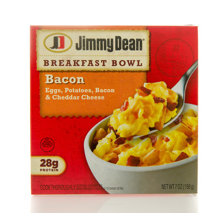 bacon and eggs: Winneconne, WI - 2 March 2016:  Box of Jimmy Dean breakfast bowl with bacon, eggs, potatoes and cheddar cheese.