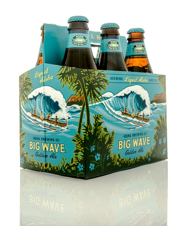 6 12: Waupun, WI - 9 March 2016: Six pack of Big Wave beer from the Kona brewing company
