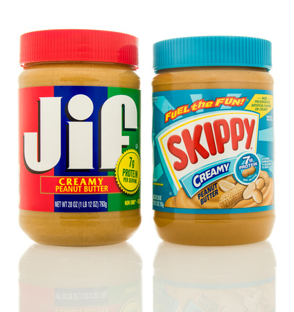 skippy: Waupun, WI - 9 March 2016: Containers of Jif and Skippy peanut butter.  The top two selling brands in America
