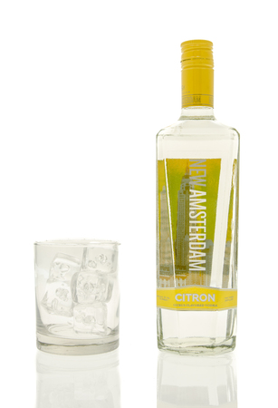 Winneconne, WI - 15 March 2016:  A bottle of New Amsterdam citron vodka with a glass of ice
