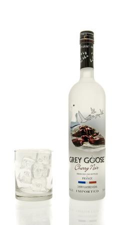 noir: Winneconne, WI - 15 March 2016:  A bottle of Grey Goose cherry noir vodka with  a glass of ice