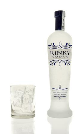 kinky: Winneconne, WI - 15 March 2016:  A bottle of Kinky vodka with  a glass of ice
