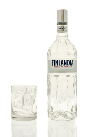 Winneconne, WI - 15 March 2016:  A bottle of Finlandia vodka with a glass of ice