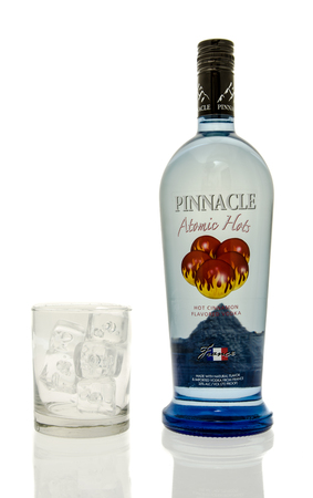 hots: Winneconne, WI - 15 March 2016:  A bottle of Pinnacle atomic hots vodka with a glass of ice