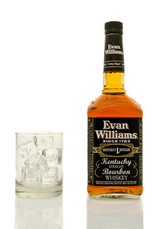 williams: Winneconne, WI - 19 March 2016:  A bottle of Evan Williams whisky with a glass of ice.