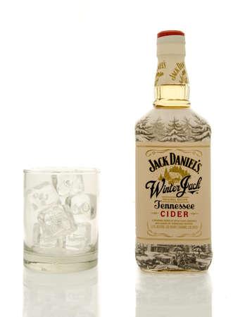 daniels: Winneconne, WI - 19 March 2016:  A bottle of Jack Daniels winter jack whisky with a glass of ice.
