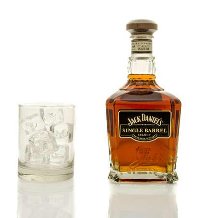 daniels: Winneconne, WI - 19 March 2016:  A bottle of Jack Daniels single barrel whisky with a glass of ice.