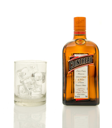 liqueur bottle: Winneconne, WI - 19 March 2016:  A bottle of Cointreau Liqueur with a glass of ice. Editorial