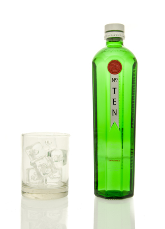 Winneconne, WI - 19 March 2016:  A bottle of Tanqueray ten gin with a glass of ice. Editorial