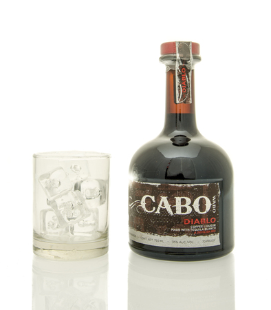 diablo: Winneconne, WI - 19 March 2016:  A bottle of Cabo, diablo coffee liqueur with a glass of ice.