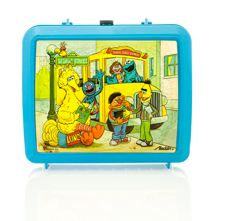 sesame street: Winneconne, WI - 29 March 2016:  Plastic lunch box from the 1980s featuring Sesame Street characters.  A popular show for kids to watch.