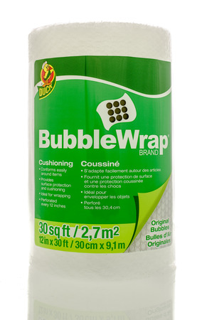 cushioning: Winneconne, WI - 1April 2016:  A roll of Bubble Wrap Brand cushioning used for wrapping things to protect them. Editorial