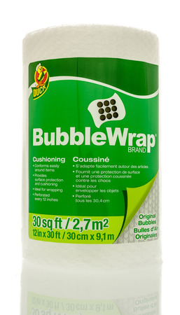 cushioning: Winneconne, WI - 3 April 2016:  A roll of Bubble Wrap Brand cushioning used for wrapping things to protect them.