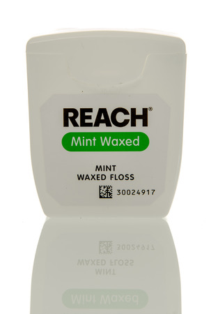 waxed: Winneconne, WI - 3 April 2016:  Container of Reach mint waxed waxed dentla floss on an isolated background. Editorial
