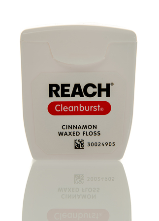 waxed: Winneconne, WI - 3 April 2016:  Container of Reach cleanburst cinnamon waxed dental floss on an isolated background.
