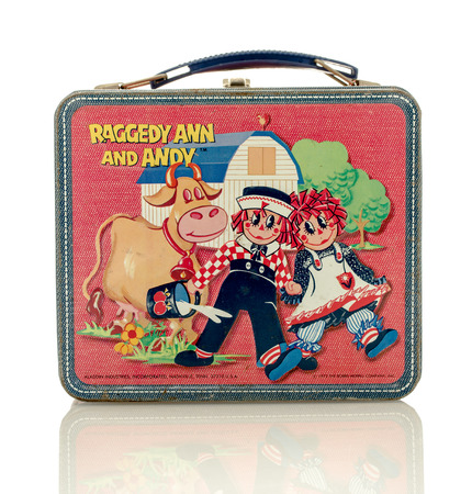 raggedy: Winneconne, WI - 8 April 2016:  Lunch box featuring Raggedy Ann and Andy on an isolated background.