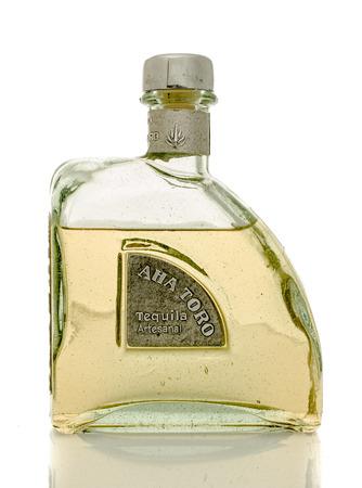 siete: Winneconne, WI - 30 March 2016: Bottle of Aha Toro Artesanal tequila on an isolated background.