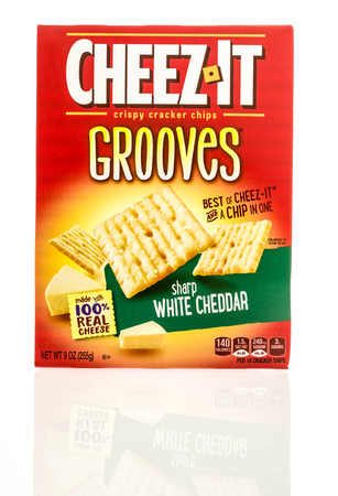 grooves: Winneconne, WI - 26 April 2016: Box Cheez it grooves in white cheddar flavor on an isolated background