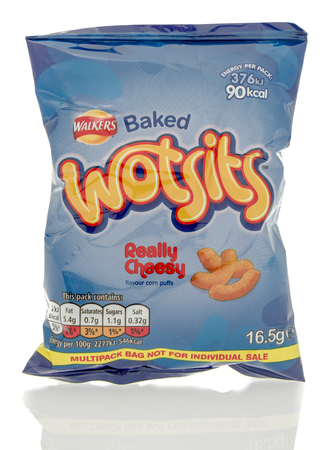 Winneconne, WI - 23 July 2016:  Bag of Walkers Wotsits really cheesy chips on an isolated background.