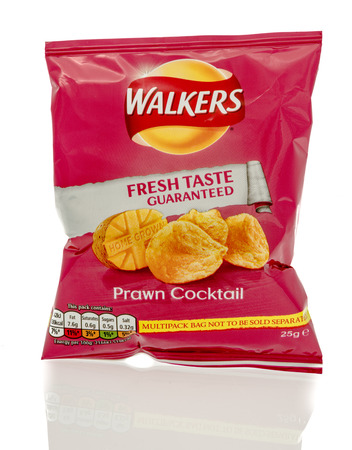 walkers: Winneconne, WI - 23 July 2016:  Bag of Walkers prawn cocktail chips on an isolated background.