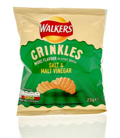 crinkles: Winneconne, WI - 29 July 2016:  Bag of Walkers crinkles in salt & malt vinegar flavour on an isolated background.