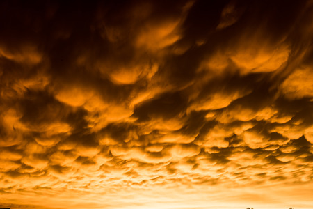 Formation of rare mammatus clouds after a thunder storm Stock Photo